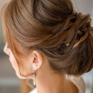 Beautiful young bride with elegant hairstyle